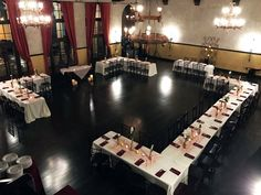 A cozy and intimate wedding reception layout utilizing rectangle tables and with huge dance floor.