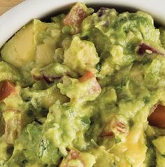 Chunky Guacamole has red onion, a jalapeno, some hot sauce and ground cumin. Throw in some garlic and you've got a condiment or a dip that will knock everyone's socks off.