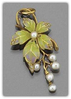 An Art Nouveau gold, pearl and enamel pendant. In the form of a single plique-a-jour green enamel vine leaf with rose-cut diamond tips suspending a five stone pearl grape drop, circa 1900.