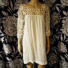 NWT unique white tunic/dress So cute & sexy white tunic. Super unique caged sleeve & neckline. hot & delicious  Dresses