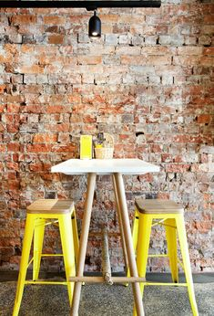 blonde wood, canary yellow, white finish and exposed brick wall, great combo Inspiring Interior in a Fish Market with fresh yellow details // Australia Cafe Industrial, Industrial Interiors, Industrial Furniture, Industrial Design, Industrial Living, Industrial Stairs, Industrial Closet, Industrial Windows, Industrial Restaurant