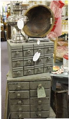 Like the idea of two of these for keurig. Cool old hardware drawers. The top one is made with old wooden cheese boxes!