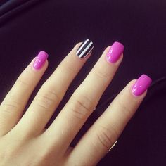Fuchsia/ Pink Nails with one black and white striped nail