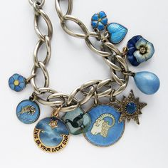 Charm bracelet with antique and vintage enamel and crystal blue charms | Silver Star Charms