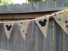 Closer pic of... I made Mickey themed banners from burlap, acrylic paint, and chevron ribbon - I pinned a Minnie bow on the middle mouse :)