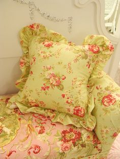 fluffy chintz for the front veranda under the 2 story columns...on antique wicker..breakfast