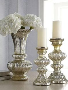 These are sooooo cute! Fall Home Decor Color Trends: Warm Metallics - Golds and Silvers are in! These are mercury glass vases...