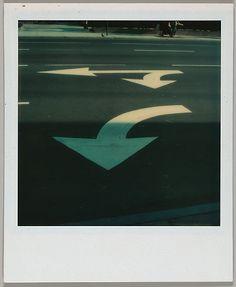 [Street Arrows] - Instant color print - December 15, 1973. Walker Evans