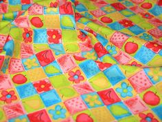 http://www.minervacrafts.com/14.e-nv-8420-b-bright-coloured-patchwork-print-cotton-poplin-fabric-per-metre.html