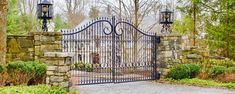 Absolutely stunning wrought-iron driveway gate with large stone pillars and iron light fixtures. Wrought Iron Driveway Gates, Iron Gates, Entrance Gates, Grand Entrance, Bedford Hills, Gate Post, Stone Pillars, Curb Appeal