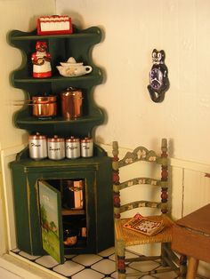 Kitchen Vignette ~ Corner cabinet I found for only $20! Filled with favorite kitchen items including J. Getzan copper pieces, K&J canisters, and a ceramic cookie jar just like the real ones my friend collects.