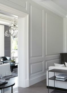 Paneling...grey walls ...touch of glam with chandelier