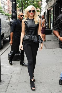 Gwen Stefani in all black, black peplum, skinny pants, open toed booties.
