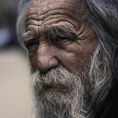 Portrait of an old homeless Avenue Foch, Paris