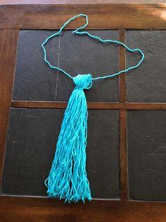 DIY yarn unicorn tail   MLP tail – step 4. Photo by Ariane Coffin.