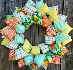 This fun retro-looking, handmade fabric wreath brings a smile as if the sun was shining on your face!  This beautiful wreath brings a warm, inviting, feel good addition to your home, your front door o