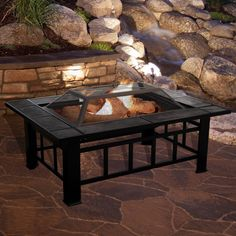 This rectangular fire pit from pure garden features a large fire bowl bordered by beautiful black and orange marbled tiles. The black powder-coated steel frame resists rusting. Includes a spark screen, log poker, log grate and weather resistant cover. Make summer parties more entertaining or enjoy the warmth of a cozy fire on a cool fall night with this stylish fire pit.