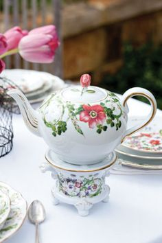 The sweet floral design on this Rosenthal-meets-Versace Flower Fantasy teapot and warmer is the perfect addition to a garden-themed tea.  From Tea Time Magazine.