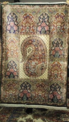 Signed Rare & Antique carpet with the Boteh motif