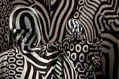 Photos of the day 09/15 Image 23 / 86 : Model feebee poses on Wednesday as part of the art installation 'Narcissism : Dazzle room,' created by artist Shigeki Matsuyama at rooms33 fashion and design exhibition in Tokyo. Matsuyama's installation features a strong contrast of black and white, which he learned from dazzle camouflage used mainly in WWI. Eugene Hoshiko/AP