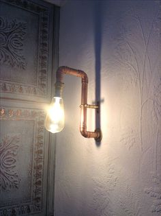 Interior copper pipe lighting. Pipe Lighting, Ethereal, Pewter, Sticks, Recycling, Wall Lights, It Cast, Copper, Interior