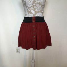 Forever 21 skirt  Burnt orange Forever 21 mini skirt. Has decorative/non-functioning buttons down the front. Has a black elastic waist. Size S. Good condition, no flaws. Forever 21 Skirts Mini