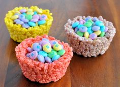 Easter: Rice Krispies M-&-M Cups....All you do is make a traditional Rice Krispies Treats recipe, add some food coloring and shape the treats (while still warm) in large muffin tin cups. I use a small bottle to press in the center and create a space to drop in some treats like pastel M-&-Ms Of course you'll want to wait until the treats have cooled before adding chocolate.