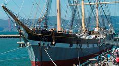 A restored historic sailing ship built in 1886 moored along a pier. San Francisco Maritime National Historical Park California