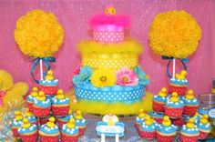 Floofy diaper cake, cupcakes and tissue topiaries we made for a girly ducky baby shower .