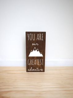 The perfect addition to a woodland, adventure, outdoor or tribal themed room! This solid pine wood sign features a dark walnut stain and white                                                                                                                                                                                 More