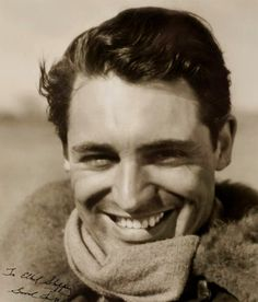 A young and delectably handsome beaming from within with million-watt smile Cary Grant.