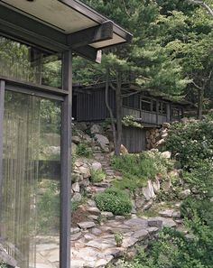 """On the land, which Wright dubbed Manitoga, he planted and cultivated native trees and wove stone paths around them. He diverted a river into an abandoned quarry, creating a pool that his daughter named Dragon Rock, as she """"likened the place where pool met stone to a dragon drinking from a pond,"""" Gotkin writes in the book."""