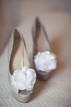 White flower clips from Claire's clipped them to the front of the shoes. A good way to dress up a pretty peek toe pump, so you can reuse them after the wedding.