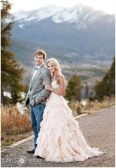 A cute couple wearing pale pink pose for photos at their elopement wedding photo session at Sapphire Point near Breckenridge, Colorado.
