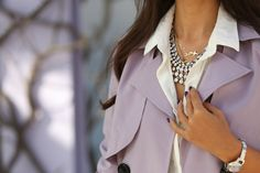 A statement necklace and a sweet-hued trench coat. Style inspiration via Viva Luxury.