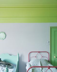Lime green at the top of a bedroom paired with white walls