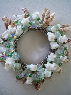 Bead and Shell Bracelet, Brown and Green Cha Cha,. $49.00, via Etsy.