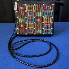 Brighton Mini Beaded Cross Body Purse This purse is 5 x 5 inches with the detachable strap height of 23 inches. Brighton Bags Mini Bags