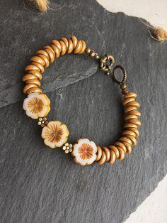 Caramel and antique bronze bracelet with pretty caramel coloured czech glass blossom beads, caramel czech glass piggy beads and a lovely chunky