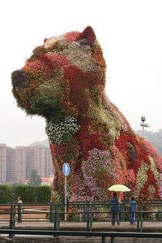 """Guggenheim Museum, Bilbao, Spain In front of the Guggenheim Art Museum you'll find an awesome example of vertical gardening in the depiction of a puppy made entirely out of plants. The artist, Jeff Koons, created this 43-foot tall ""plant puppy"" in the mid-1990s using a steel substructure and a variety of plants. The detail of this piece is amazing."""