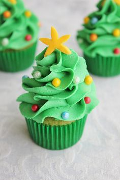 Mini Christmas Tree Cupcakes - These mini Christmas tree cupcakes are super easy and fun to make. All it takes is some buttercream icing, piping bags, tips and sprinkles. You can be as creative as you like, there is more than one way to pipe a tree!