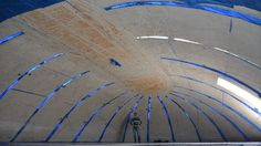 """New construction technique allows concrete domes to be """"popped up"""" By Ben Coxworth June 2014 Inside a test dome built using the pneumatic wedge method Shell Structure, Timber Structure, Concrete Structure, Construction Process, Construction Design, Scaffolding Materials, Temporary Architecture, Material Research, Colonial House Plans"""