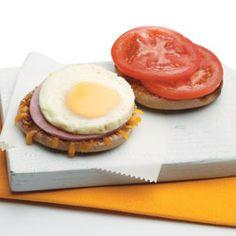HEALTHY twist on the traditional Egg Sandwich. This one is made with wheat English muffins, lower-sodium ham, reduced-fat cheddar cheese and tomato slices.