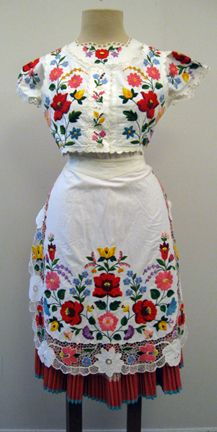 Hungarian folk costume with blouse, vest, pleated skirt, and apron