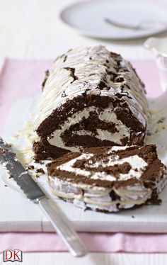 Mary Berry's recipe for Chocolate and Irish Cream Roulade from Mary Berry Cooks the Perfect. It's one of Mary's all-time favourite party desserts as you can make it ahead and it also freezes beautifully (un-iced). All you need to do is simply thaw the roulade in the fridge overnight and drizzle over the icing just before serving.