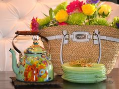 Create a whimsical spring centerpiece with a rattan handbag instead of a traditional basket, and fill it with vibrant blooms!  A great way to bring Spring indoors!