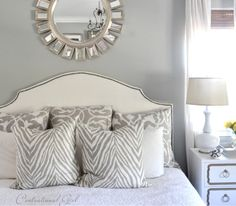 The master bedroom is another custom blend – it's a mix of 1/2 Camouflage and 1/2 Misted Green, both by Benjamin Moore.  The closest color match is 'Comfort Gray' by Sherwin Williams.