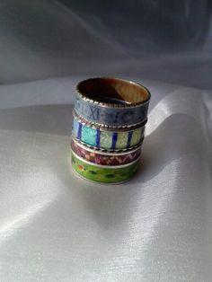 Olga Doutkevitch- rings ! Enamel of every colour.