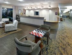 """Project:Best Western Branson Inn & Conference Center  Branson, MO  PRODUCTS Shaw Hospitality Group Vivid Palette custom print and LVT Uncommon Ground 6"""" plank DESIGN FIRM bcDESIGNGROUP"""