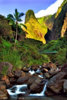 'Iao Valley State Park Needle Maui Hawaii Tropical waterfall rapids rocks and trees.
